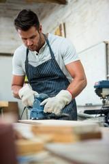 Carpenter working on his craft