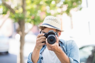Man taking photo outdoors