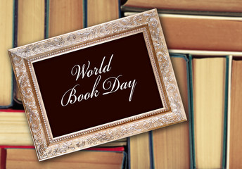 World Book Day concept. Text in frame on blurred books background