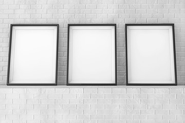 Blank Picture Frames on the Brick Wall. 3d Rendering