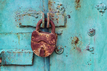 Old padlock on a blue door