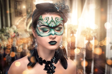 Woman with art make up green mask