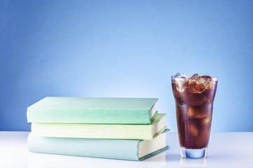 Books with a ice coffee.