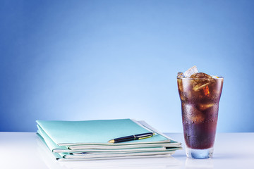 Office supply with a ice coffee.