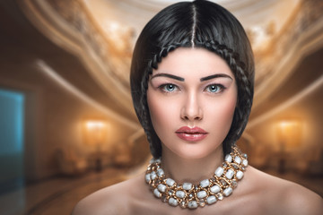 Beautiful intelligent woman in a church or a picture gallery. Art Muse writer looking for inspiration in the high architecture. Collar, Baroque era or the Middle Ages. Golden picture, luxury lady