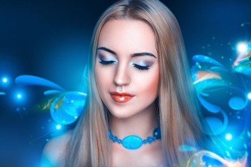 Beautiful woman with long blonde stylish hair style, art make up with bright vivid colors shadows, red intensive lips. Full fashion look close up. decorative swirls, monograms, patterns background