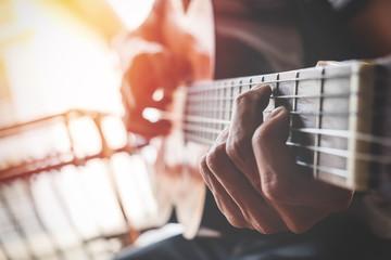 boys hand with a guitar