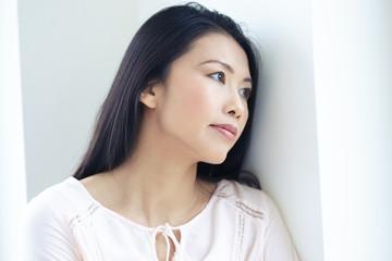 Asian Woman At Window