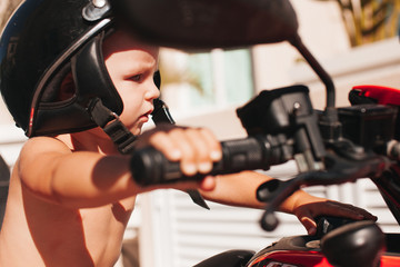 Boy holding the bike steering