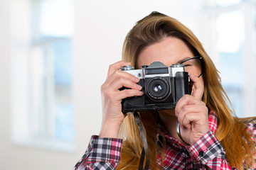 Female photographer holding a vintage camera