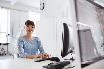 happy asian woman with computer at office