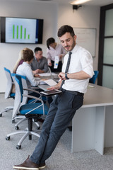 young business man with tablet at office meeting room