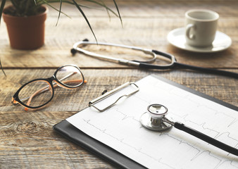 doctor workplace with a stethoscope at wooden table