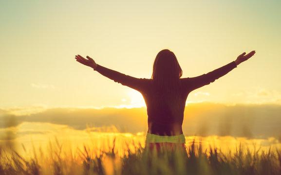 Woman feeling free in a beautiful natural setting.