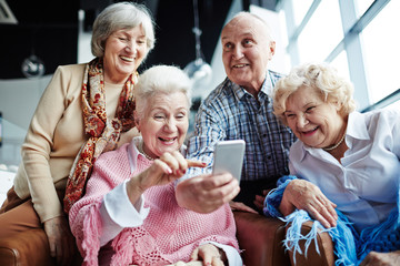 Seniors with smartphone