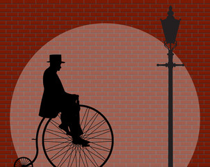 Penny Farthing Gentleman Brick Wall With Spotlight