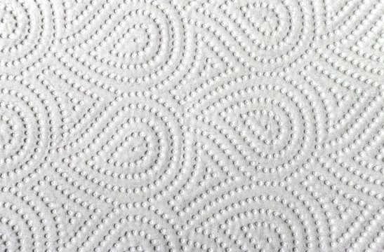 White paper towel.Close-up view of ornamented paper napkin  texture background.