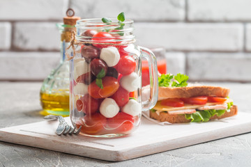 Caprese in a jar for lunch.