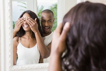 Young man covering womans eyes