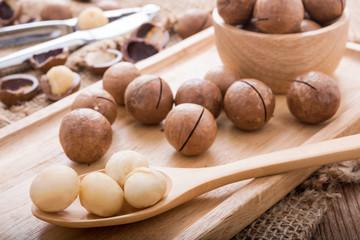 macadamia nut set on the wooden table