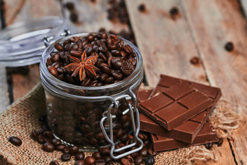 Coffee beans, chocolate and star anise in jar