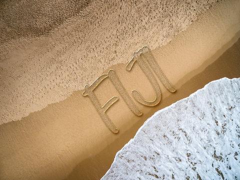 Fiji written on the beach