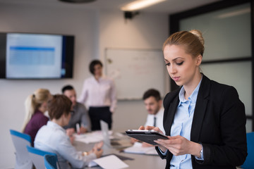 business woman working on tablet at meeting room