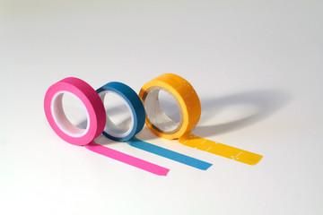 Washi tape rolls, masking tape rolls unrolled. Isolated on white background
