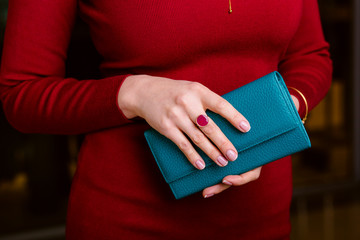 respectable woman holding wallet.