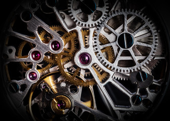 Mechanism, clockwork of a watch with jewels, close-up. Vintage luxury