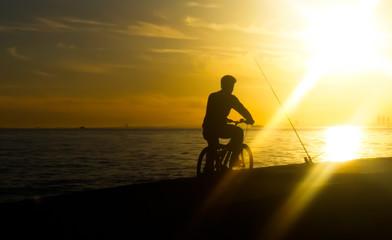 Biker in cloudy sunset