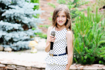 school aged girl with the microphone