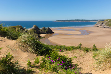 Wall Mural - Three Cliffs Bay the Gower Wales uk in summer sunshine beautiful part of the peninsula