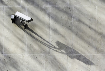 CCTV Camera on Wall with Shadow