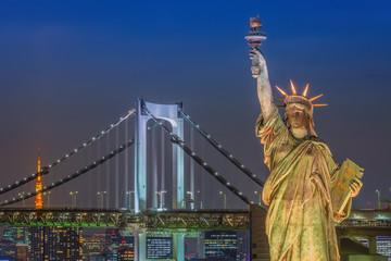 Statue of Liberty and Rainbow bridge, located at Odaiba Tokyo, w