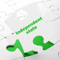 Political concept: Independent State on puzzle background