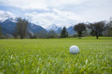 detail of golf ball on grass
