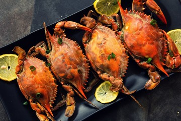 Steamed Blue crabs with lemon garnish