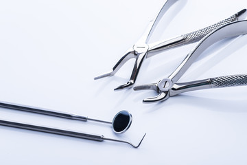 Basic dental tools on white table