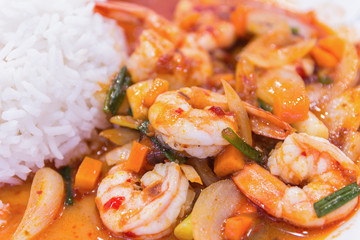 stir fried shrimp in thai red curry paste with rice and fried eg