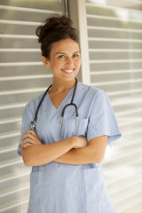 Happy confident female medical doctor