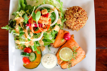 Salmon steak in white plate. Food in Thailand
