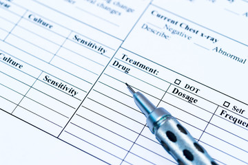 Medical record form with pen