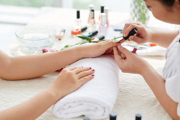 Woman having her nails done in beauty salon