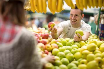 salesman offers at street market.