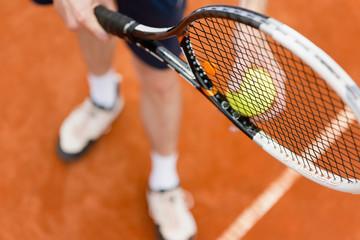 Tennis player on serve