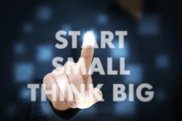 Businessman touching Start Small Think Big