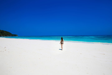 Enjoyment. Seashore. Happy free woman on tropical beach, exotic