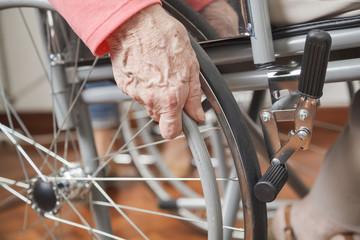Elderly Woman's hand on Wheelchair
