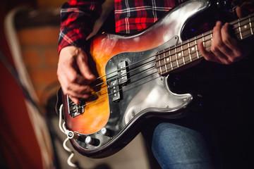 Rock music background, bass guitar player